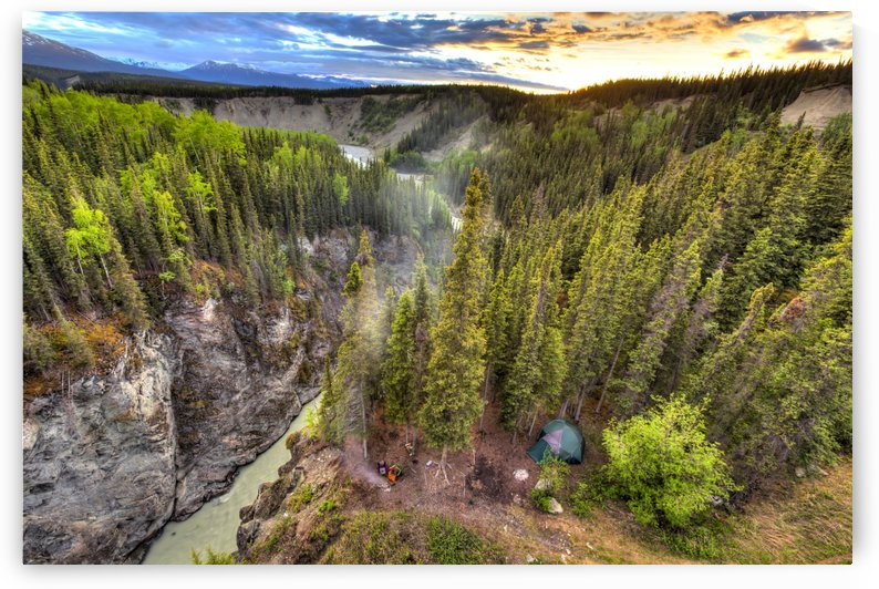 Scenic view of the Kuskulana River Canyon and Wrangell Mountains at sunset from the Kuskulana River Bridge on the McCarthy Road in Wrangell-St. Elias National Park and Preserve, Southcentral Alaska, Spring, HDR by PacificStock