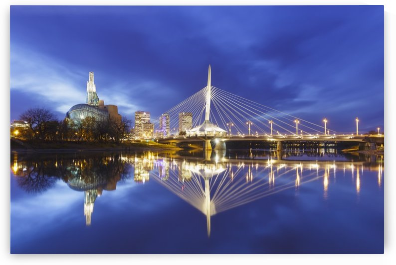 Canadian Museum for Human Rights and Esplanade Riel bridge reflected in the Red River; Winnipeg, Manitoba, Canada by PacificStock
