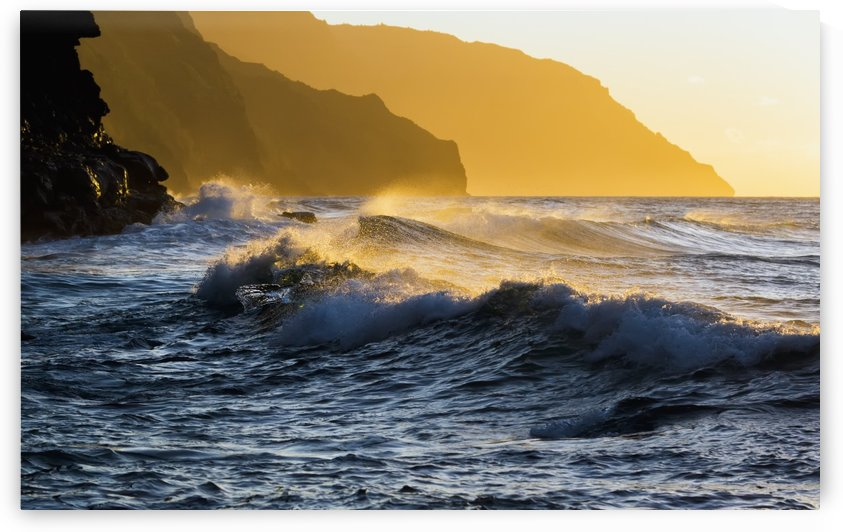 Golden surf looking down the Na Pali Coast; Wainiha, Kauai, Hawaii, United States of America by PacificStock