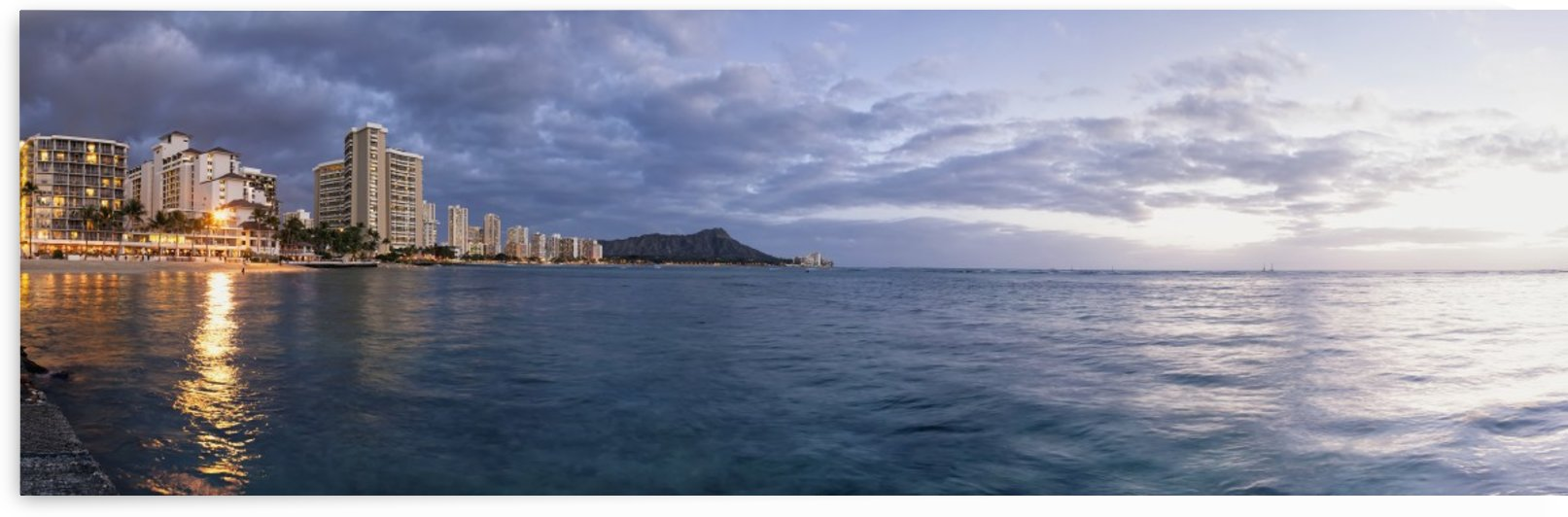 Waikiki Beach basking in the last moments of a days sunlight; Honolulu, Oahu, Hawaii, United States of America by PacificStock