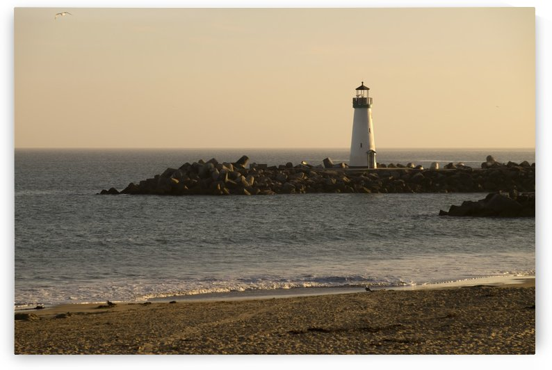 Sunset over the Walton Lighthouse at the Santa Cruz Harbor and Monterey Bay; California, United States of America by PacificStock