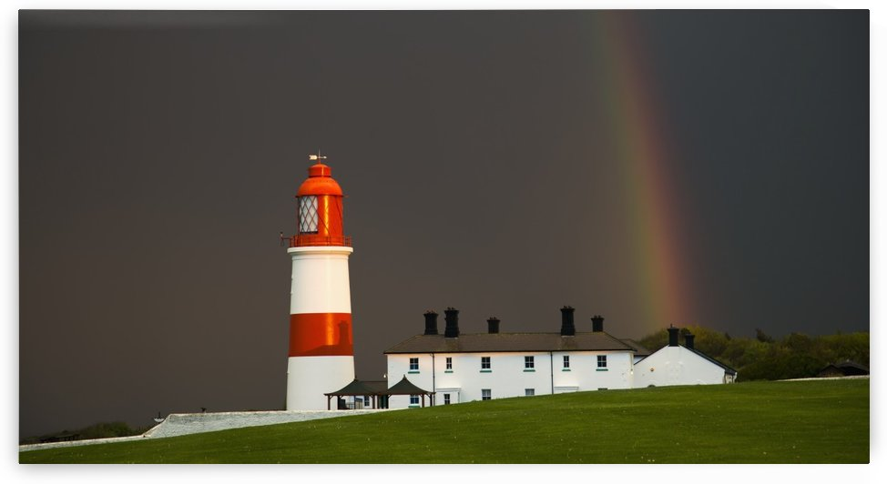 Rainbow and a red and white lighthouse; South Shields, Tyne and Wear, England by PacificStock