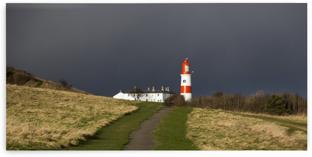 Lighthouse at the end of a path with storm clouds; South Shields, Tyne and Wear, England by PacificStock