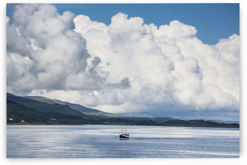 Billowing cloud and a boat in the ocean off the coast; Isle of Mull, Argyll and Bute, Scotland by PacificStock