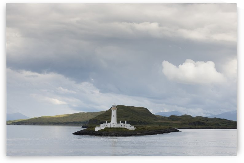 White lighthouse along the coast; Scotland by PacificStock