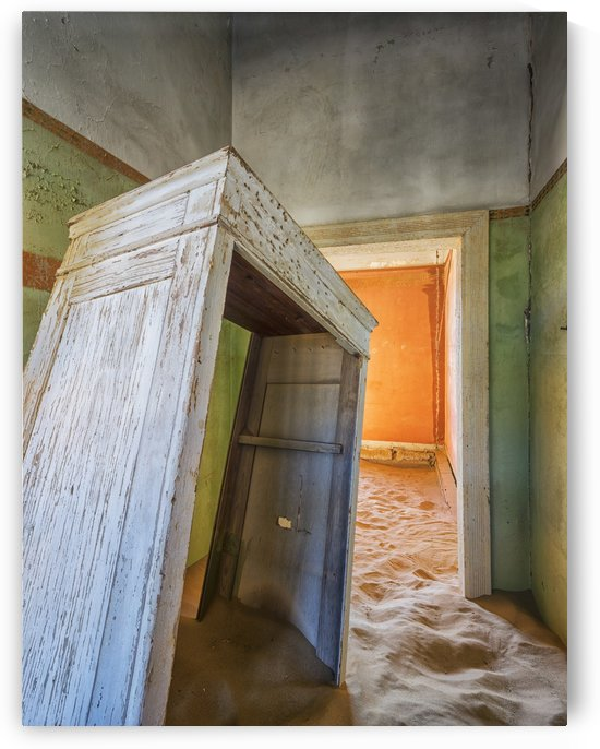 Sand in the rooms of a colourful and abandoned house; Kolmanskop, Namibia by PacificStock