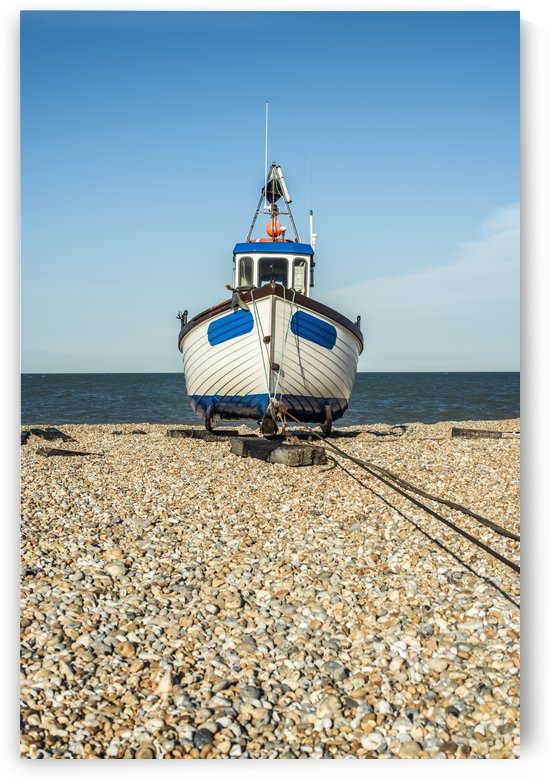 A boat on a shingle beach; Dungeness, Kent, England by PacificStock