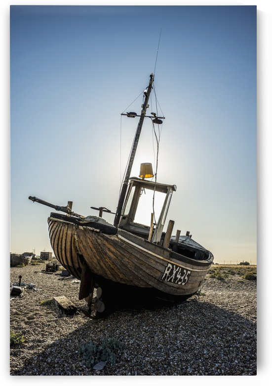 Old boat on a shingle beach; Dungeness, Kent, England by PacificStock