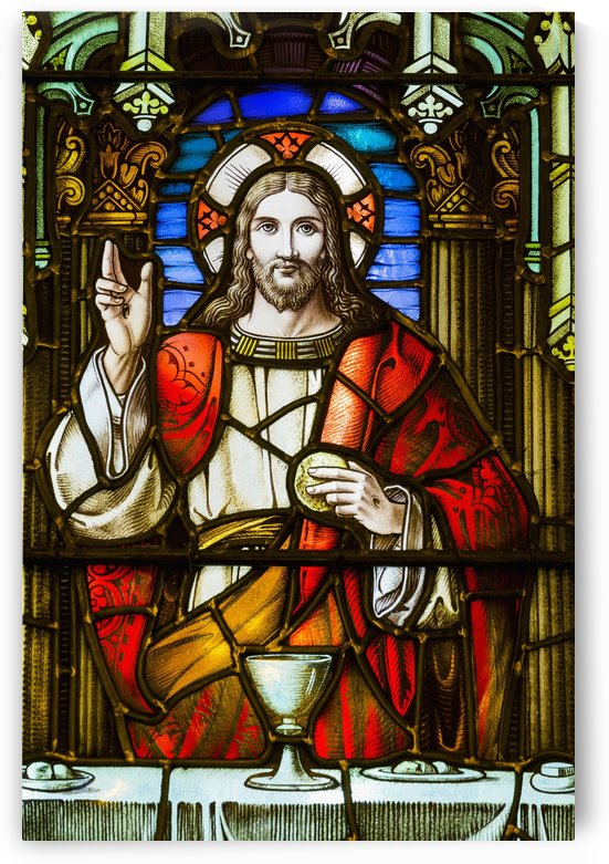 Close up of stain glass window with Jesus Christ at a table with chalice  and holding bread; Calgary, Alberta, Canada by PacificStock