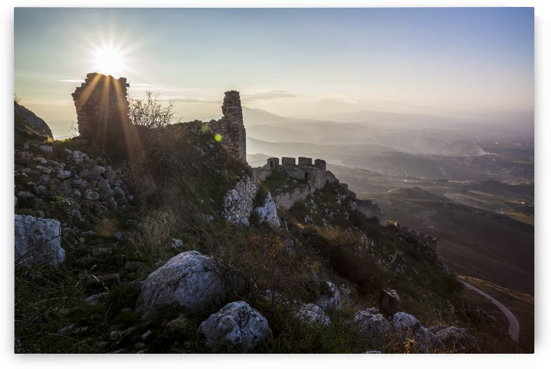 Ruins of a stone building and sunburst; Corinth, Greece by PacificStock