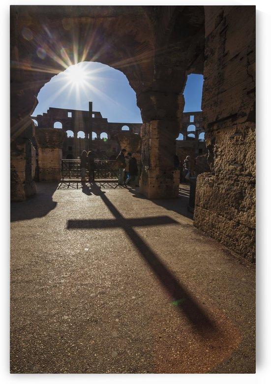 Sunburst through an archway at the Colosseum and a shadow of a cross; Rome, Italy by PacificStock