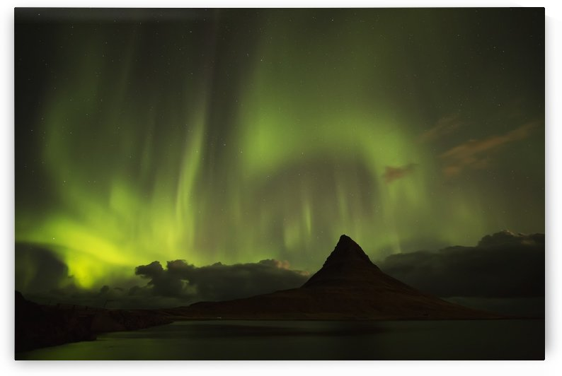 Northern lights over top of Kirkjufell, the most photographed mountain in Iceland; Iceland by PacificStock