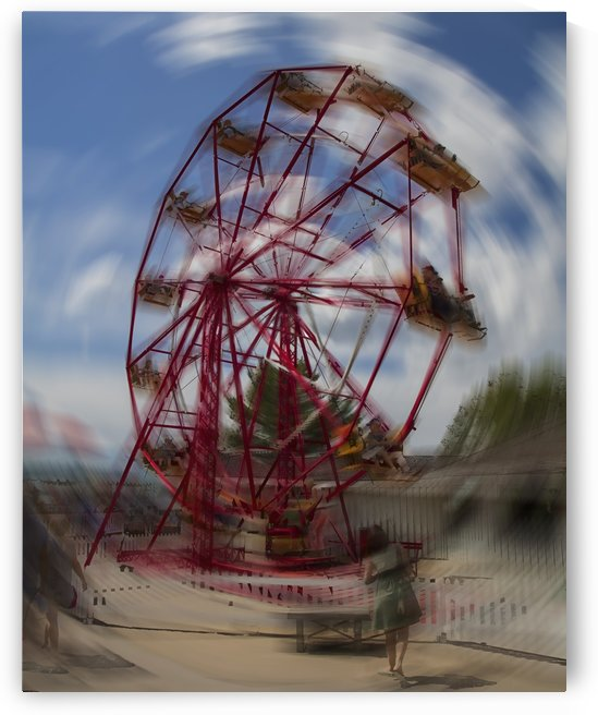Ferris wheel at amusement park, motion blur;   Calgary, Alberta, Canada by PacificStock