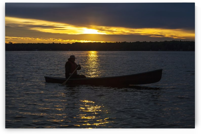 Man paddling canoe at sunrise on Balsam Lake; Ontario, Canada by PacificStock