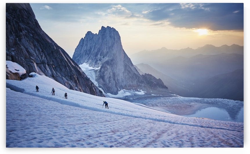 Hiking around a crevice of West Ridge of Pigeon Spire route in the Bugaboos Provincial Park at dawn; British Columbia, Canada by PacificStock
