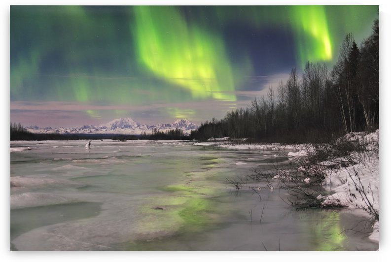 Aurora borealis over frozen Susitna River with Mt. Foraker and Mt. Hunter in the background. by PacificStock
