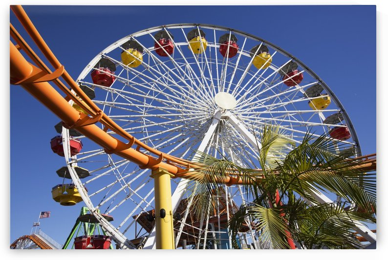 Roller coaster and ferris wheel, Pacific Park; Santa Monica, California, United States of America by PacificStock