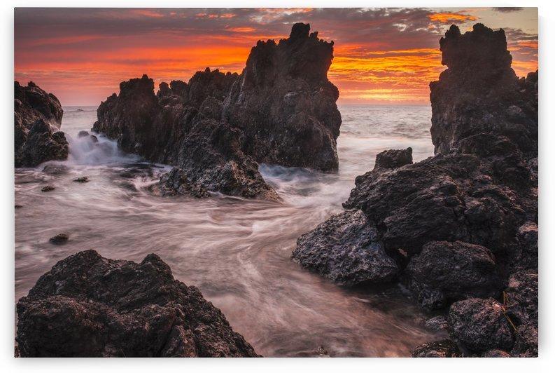 The colours of sunrise behind coastal lava rocks; Laupahoehoe, Island of Hawaii, Hawaii, United States of America by PacificStock