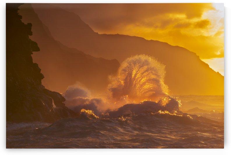 Surf crashes on the Na Pali coast at sunset; Kauai, Hawaii, United States of America by PacificStock