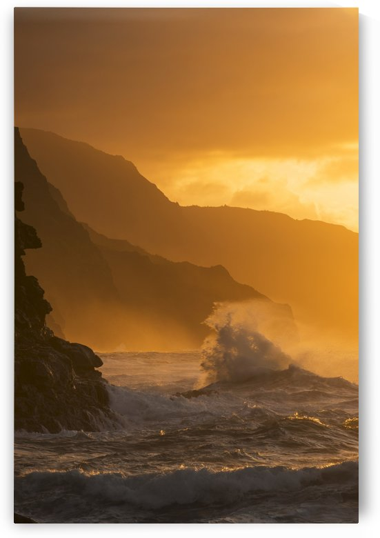 Surf breaks on the Na Pali coast at sunset; Kauai, Hawaii, United States of America by PacificStock