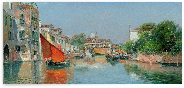 Boats along a Venetian canal by Rubens Santoro