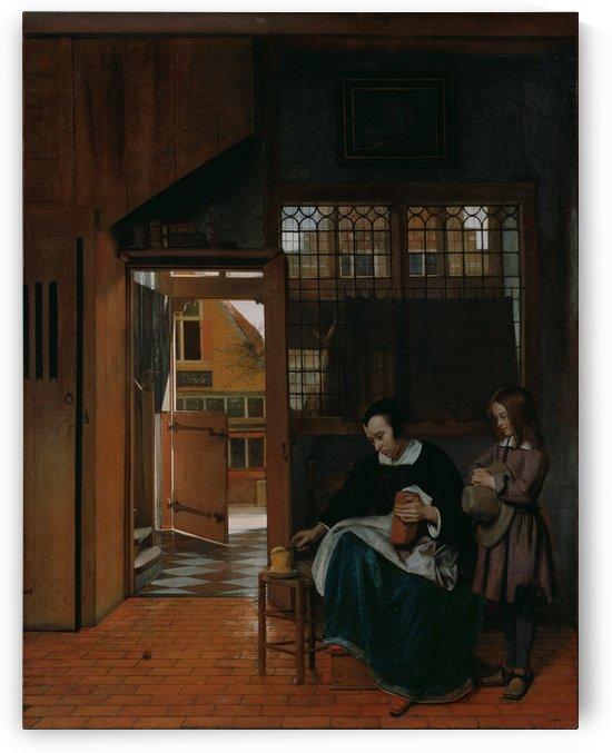 A woman preparing bread and butter for a boy by Pieter de Hooch