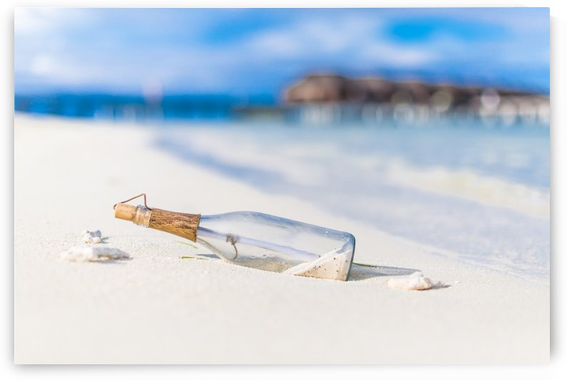 Bottle with a message at sunset in Maldives by Levente Bodo