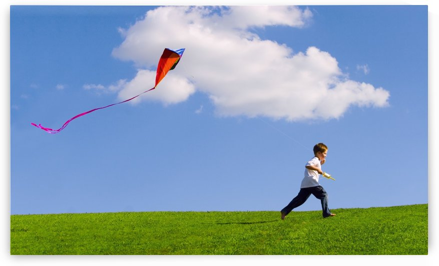 Child Flying A Kite by PacificStock