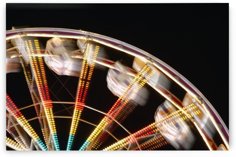 Amusement Park Ride Blurred by PacificStock