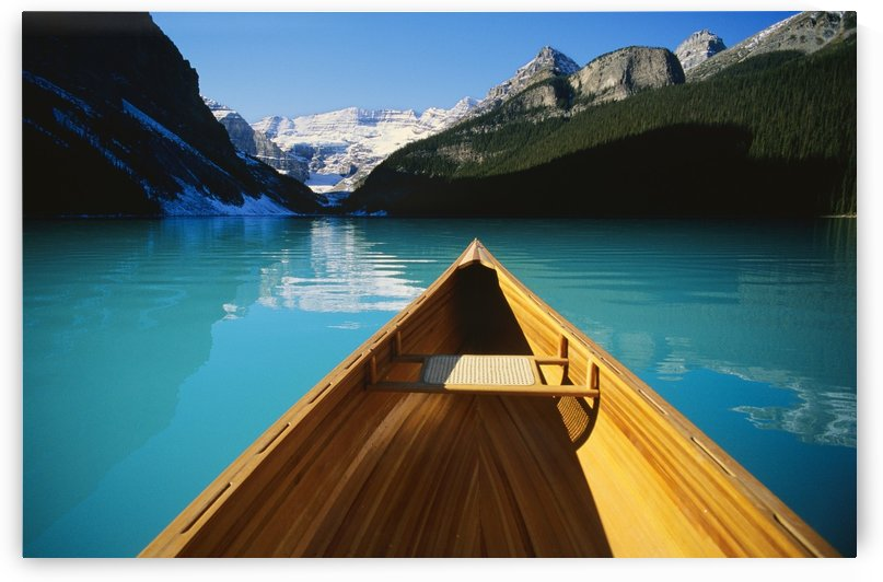 Canoe On Lake Louise In Alberta, Canada by PacificStock