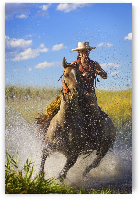Woman Riding A Horse by PacificStock