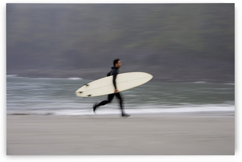 A Surfer, Running With Board Along The Shoreline by PacificStock