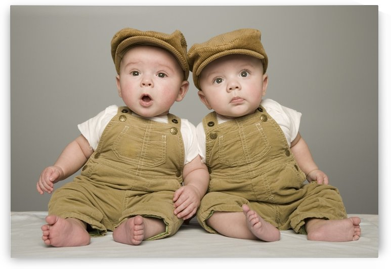 Two Babies In Matching Hat And Overalls by PacificStock