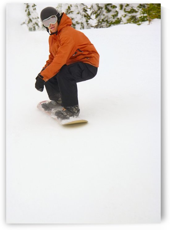 Snowboarder Going Down Snowy Hill by PacificStock