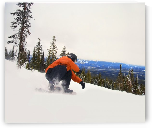 Snowboarder Crouching Down Low As He Descends Snow Hill by PacificStock