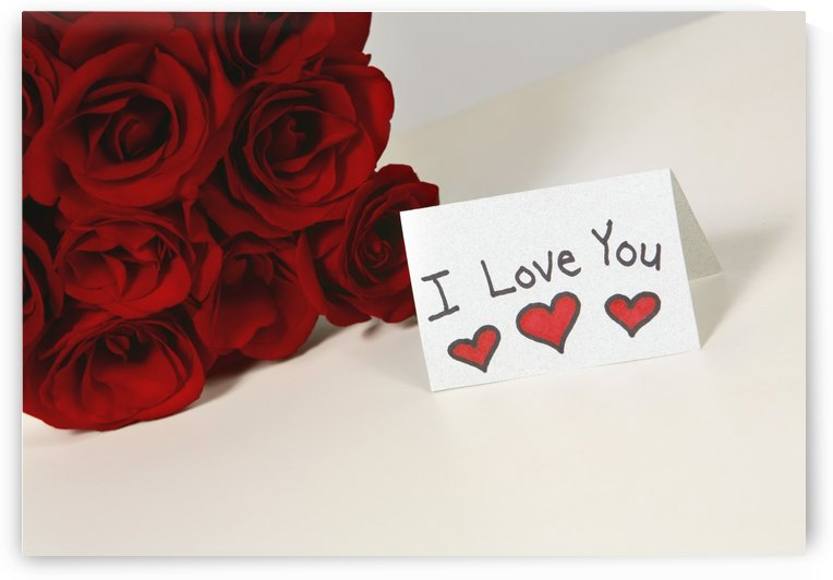 I Love You Card Beside Roses by PacificStock