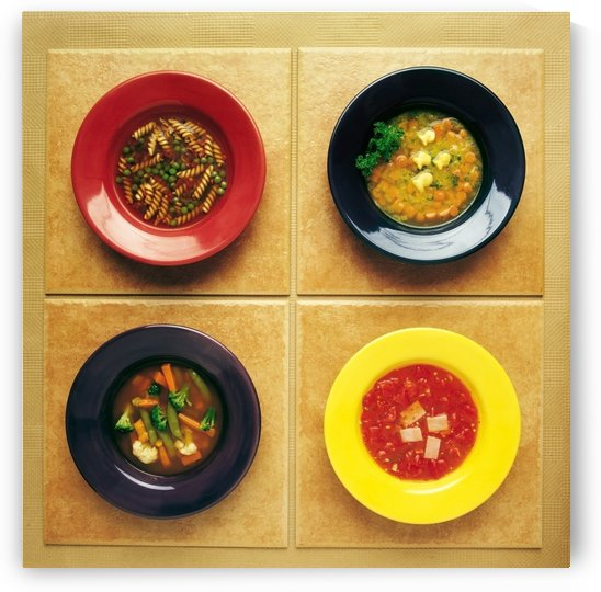 Four Plates Of Different Foods by PacificStock