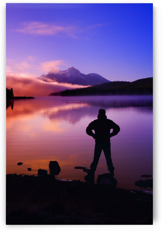 Silhouette Of A Man At A Mountain Lake by PacificStock