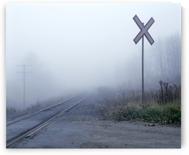 Railway Crossing In The Fog by PacificStock