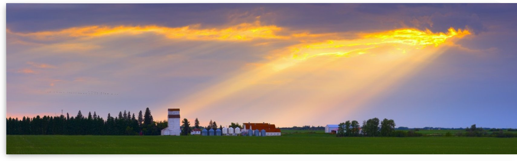 God Beams Over Prairie Farm by PacificStock