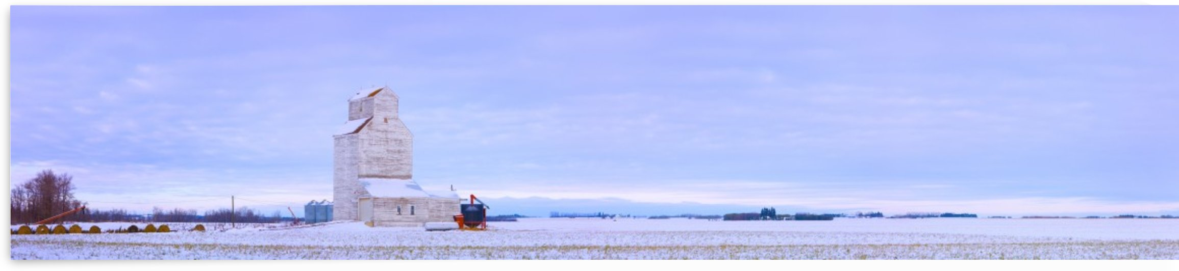 Grain Elevator In Early Winter Field, Morinville, Alberta, Canada by PacificStock
