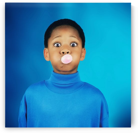 A Boy Blowing A Bubble by PacificStock