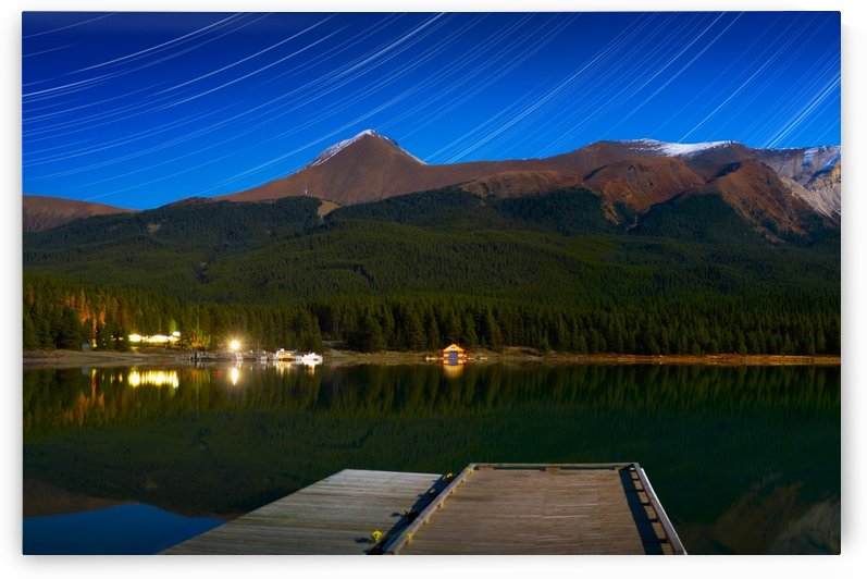 Starry Night Of Mountains And Lake, Maligne Lake, Jasper National Park, Alberta, Canada by PacificStock