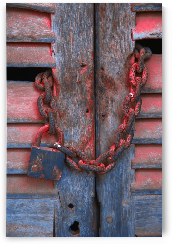 Padlock And Chain On Wooden Door by PacificStock