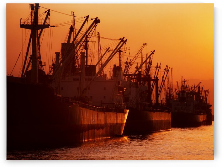 Shipping Freighters At Sunset by PacificStock