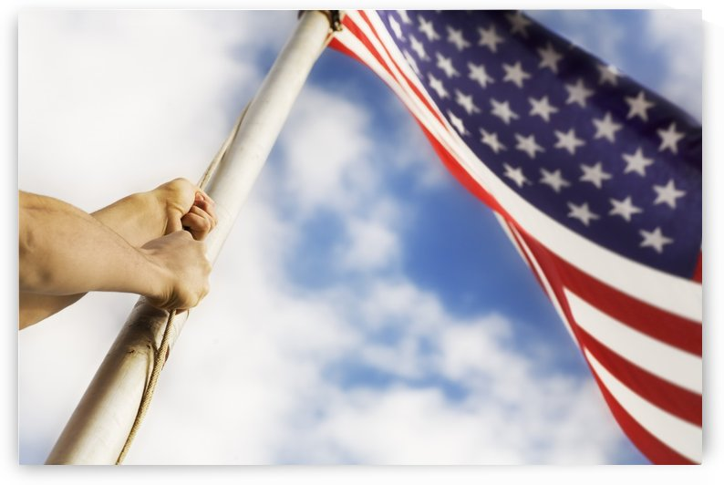 Raising An American Flag by PacificStock