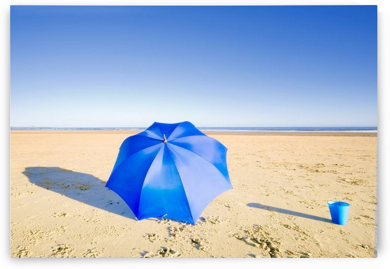 An Umbrella And A Pail On The Beach by PacificStock