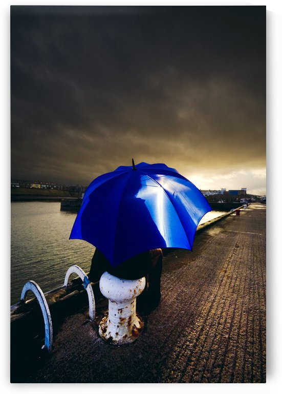 Person With Umbrella In Stormy Skies by PacificStock