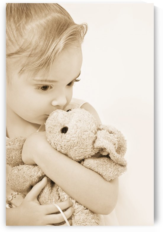 Girl Kissing Her Stuffed Animal by PacificStock