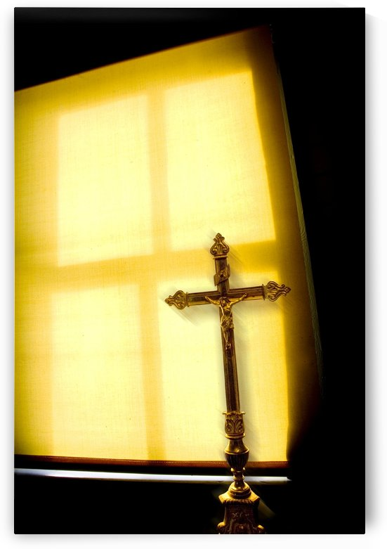 Crucifix Next To A Window by PacificStock